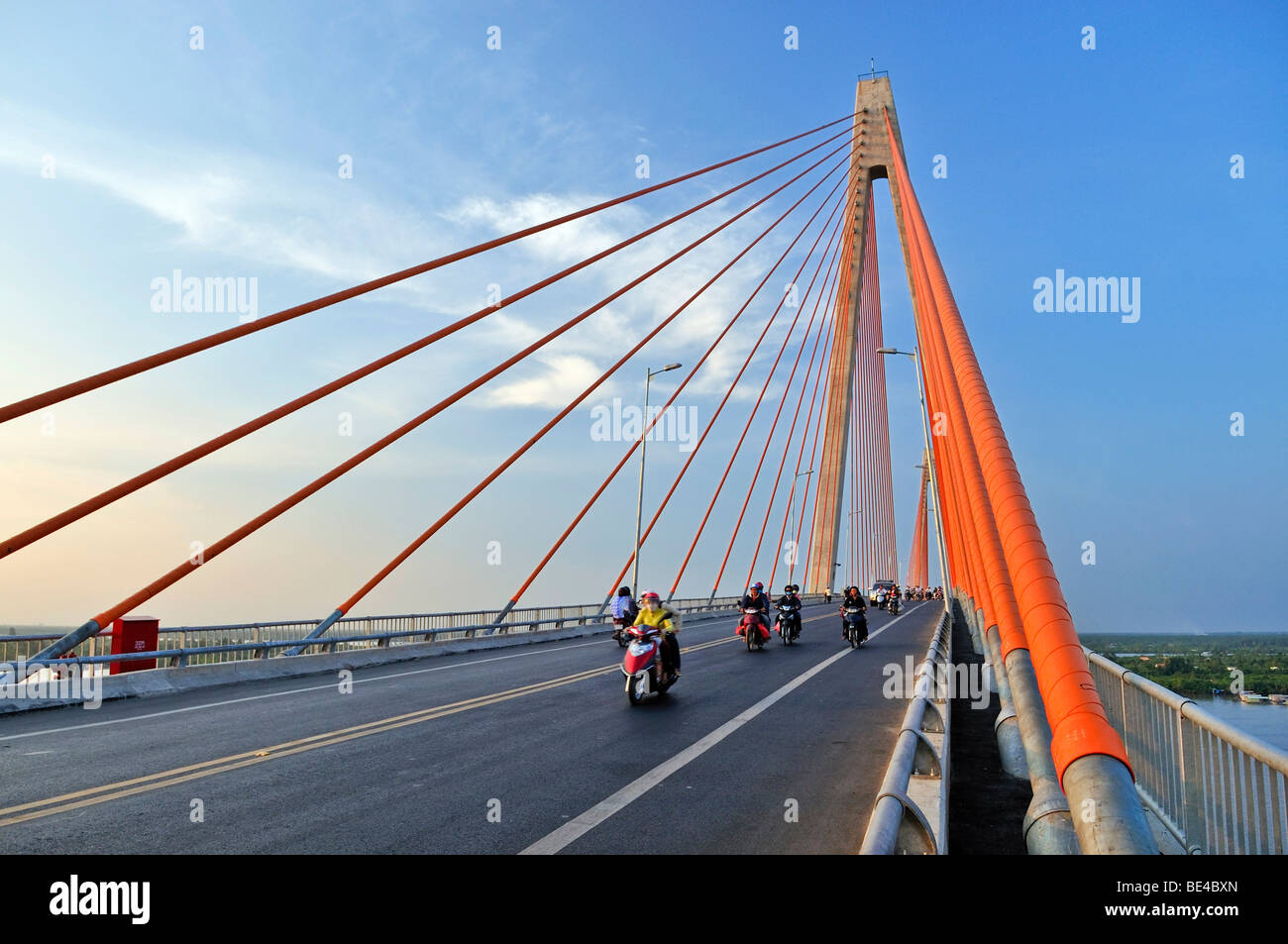 Large bridge crossing over the Mekong River, scooters on the road, My Tho, Mekong Delta, Vietnam, Asia - Stock Image