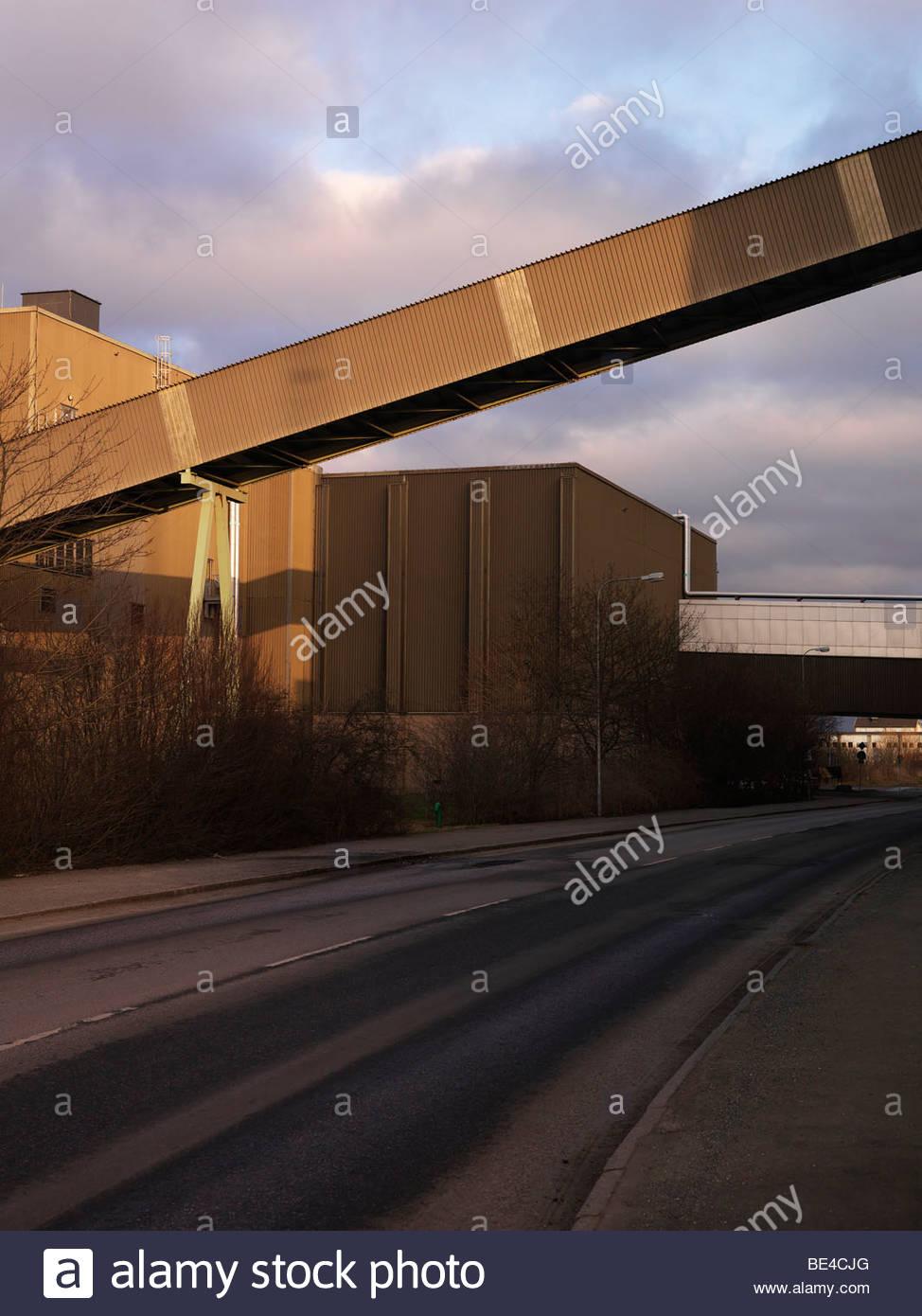 Bridge across a road Stock Photo