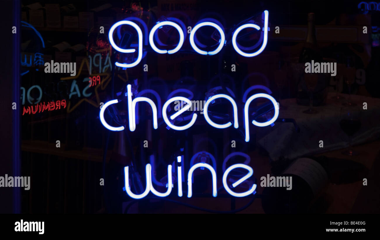 Neon sign promoting good cheap wine. - Stock Image