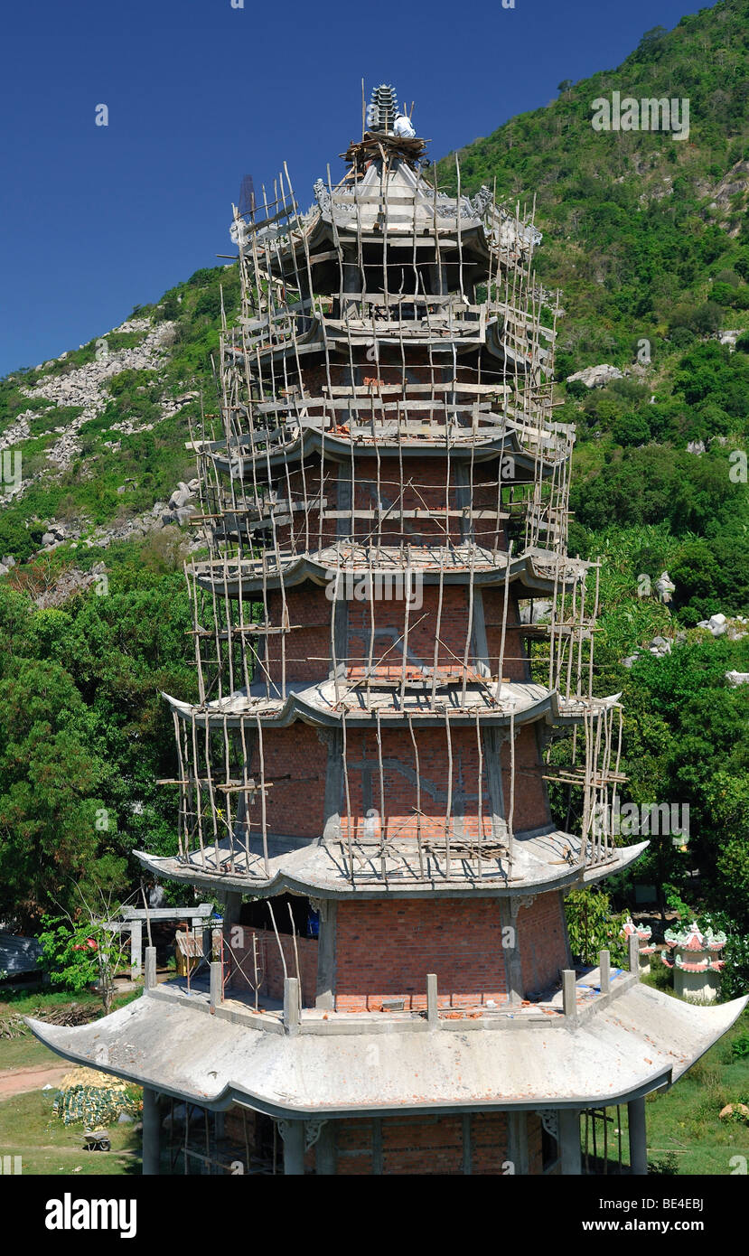 Framing with a simple scaffolding, temple tower on the mountain of the Black woman, Nui Ba Den, Tay Ninh, Vietnam, - Stock Image