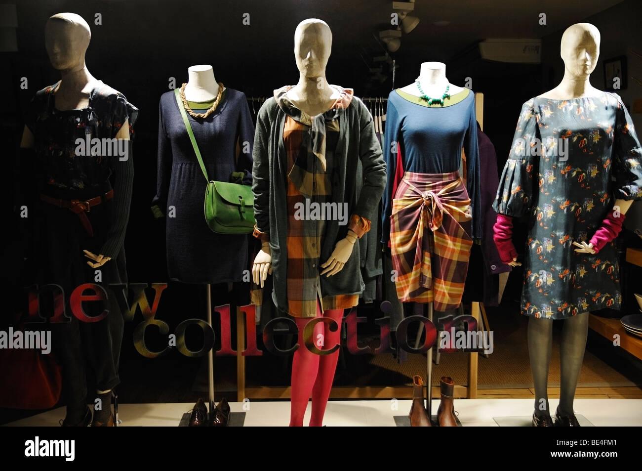 Manikins in a Shop Window. - Stock Image