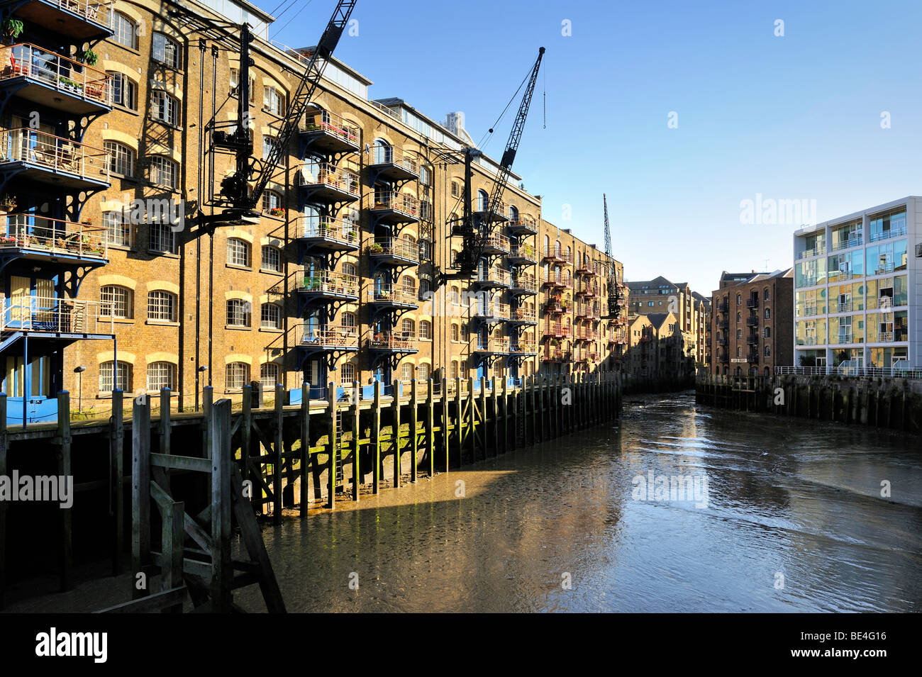 Former grain store in New Concordia Wharf, converted into residences, London, England, United Kingdom, Europe - Stock Image