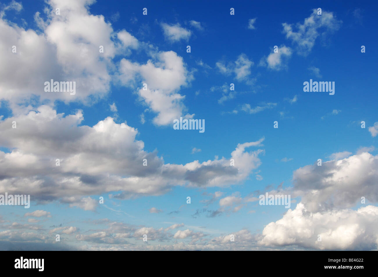 Blue sky with fluffy clouds in sunshine day - Stock Image