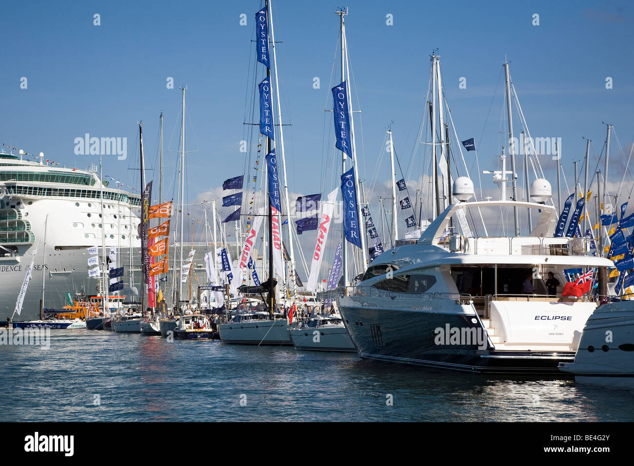Southampton Boat Show Pontoons yacht floating flags liner success sales advertising impress wealth luxury motor - Stock Image