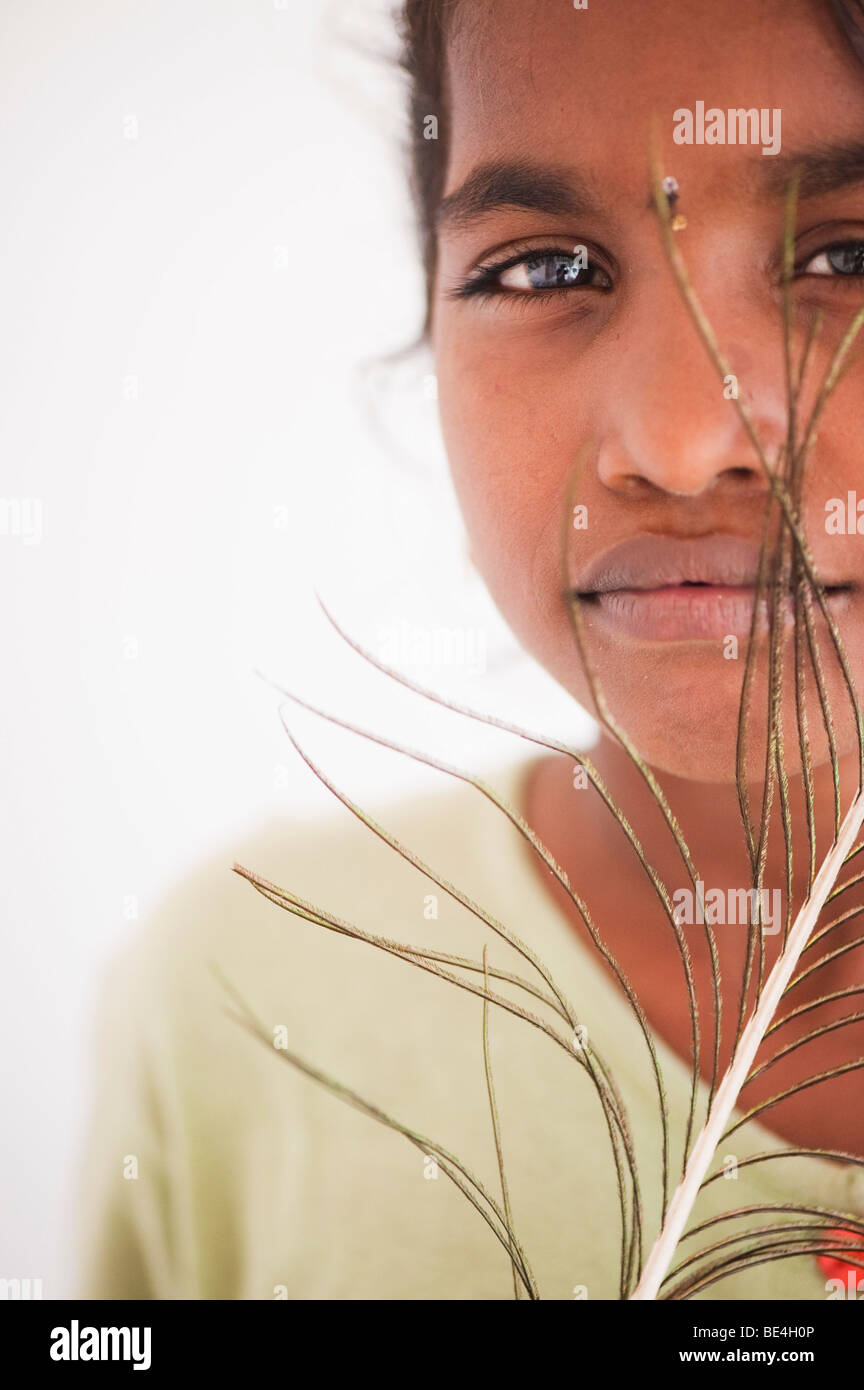 Indian girl holding a peacock feather - Stock Image