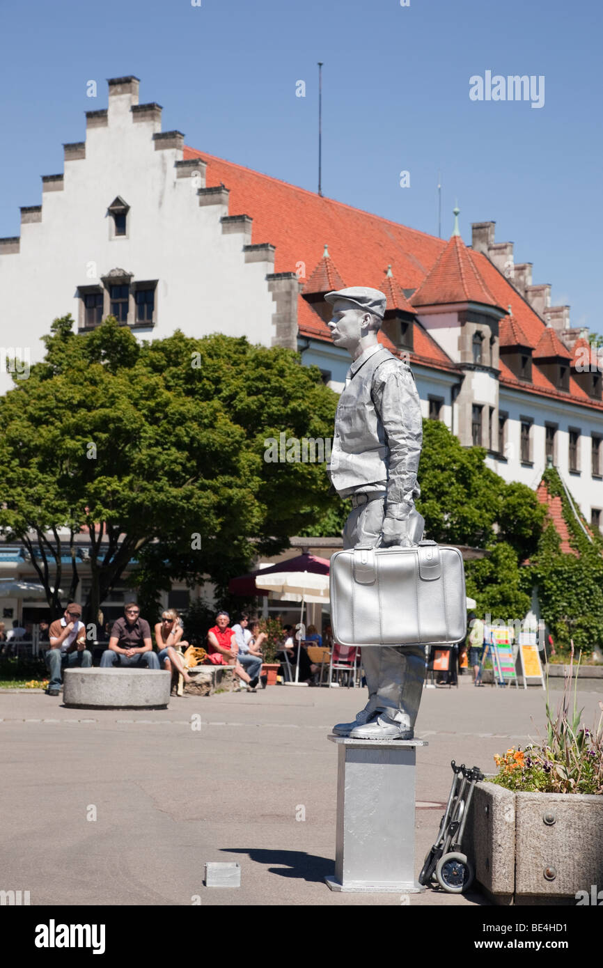 Lindau, Bavaria, Germany. Living statue mime artist on waterfront promenade in picturesque Old Town (Altstadt) on Stock Photo