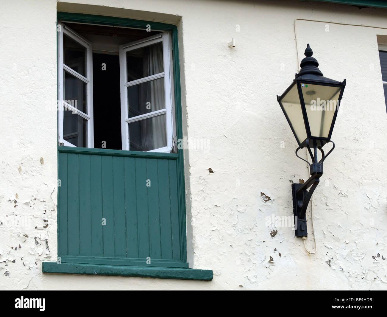 Converted hayloft door and gas lantern at Wareham,Dorset. - Stock Image