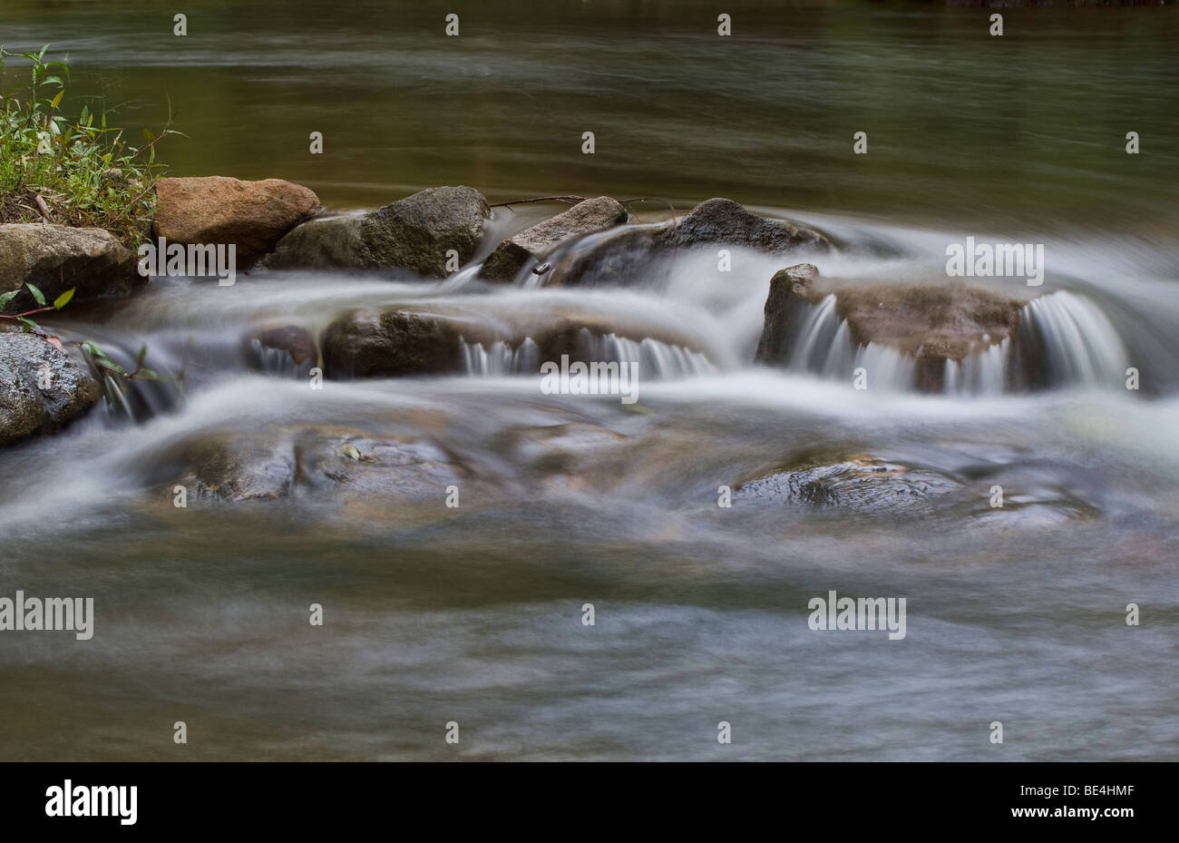 great image of water on rocks in the stream or river - Stock Image