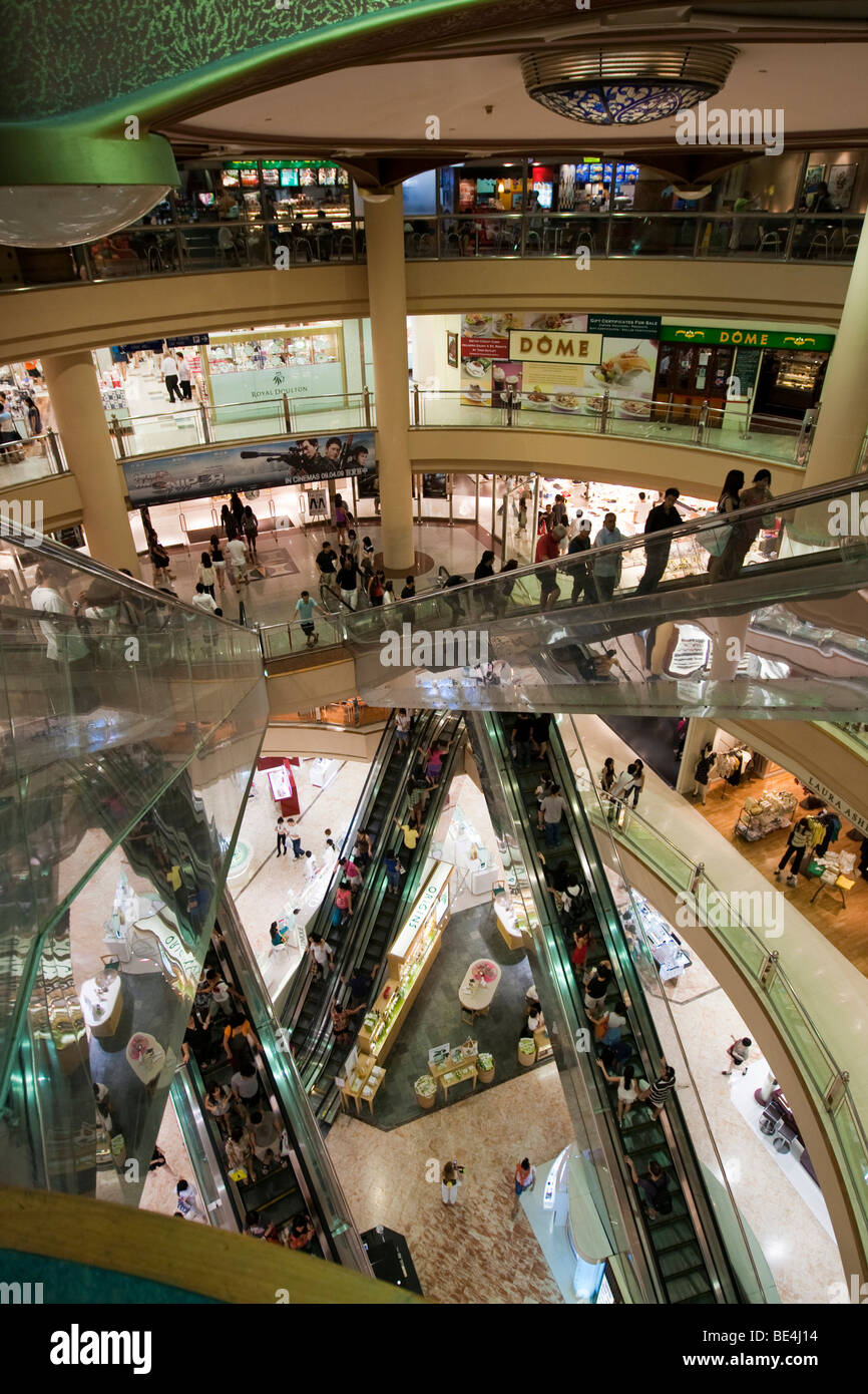 Tourists and locals shopping in a shopping center, Orchard Road, Singapore, Southeast Asia - Stock Image