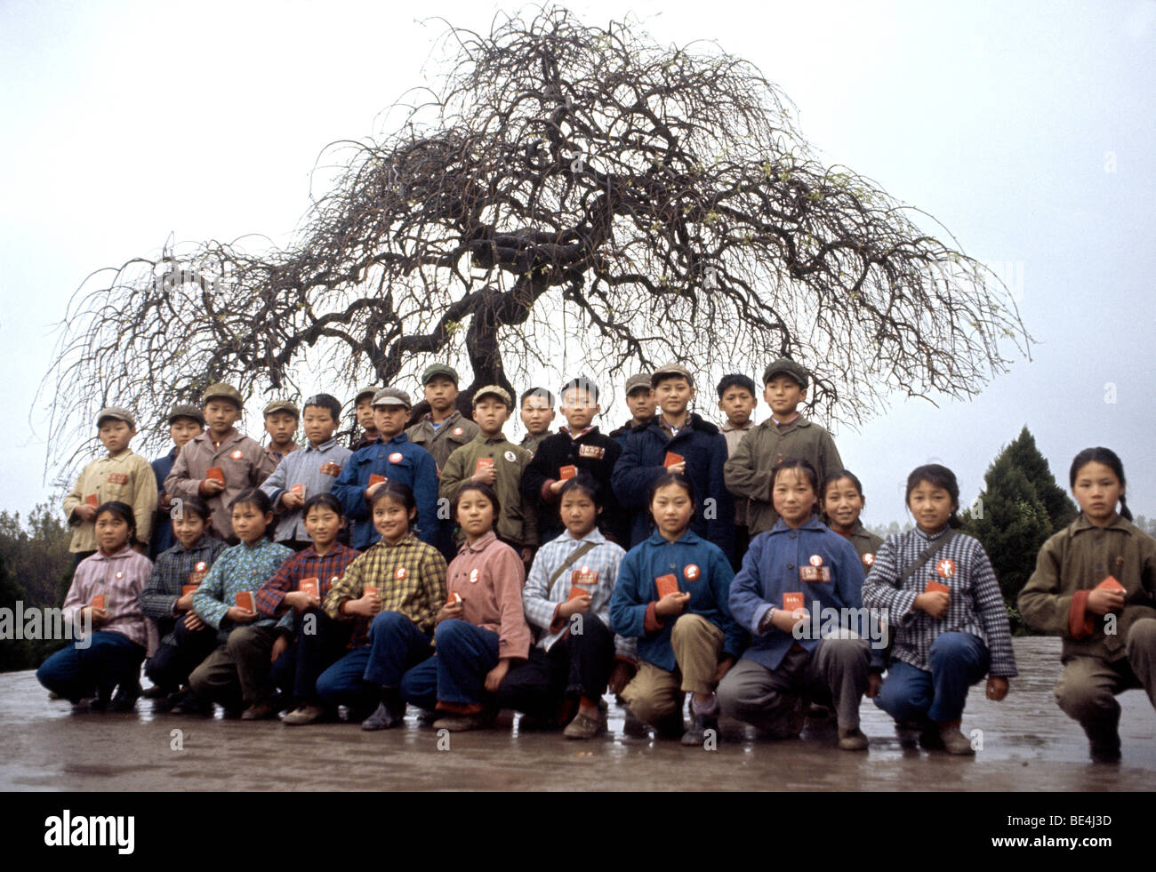 Commune near Canton during the Cultural Revolution where children pose with their Little Red Books. - Stock Image