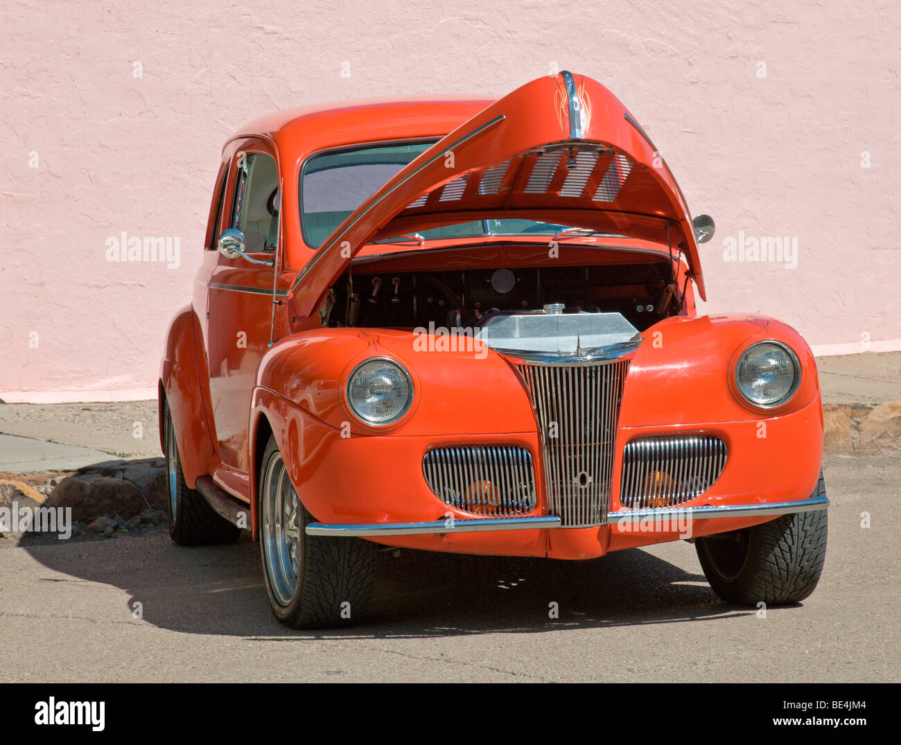 A red-hot roadster is ready for inspection at the Street Festival in Carrizozo, New Mexico. - Stock Image