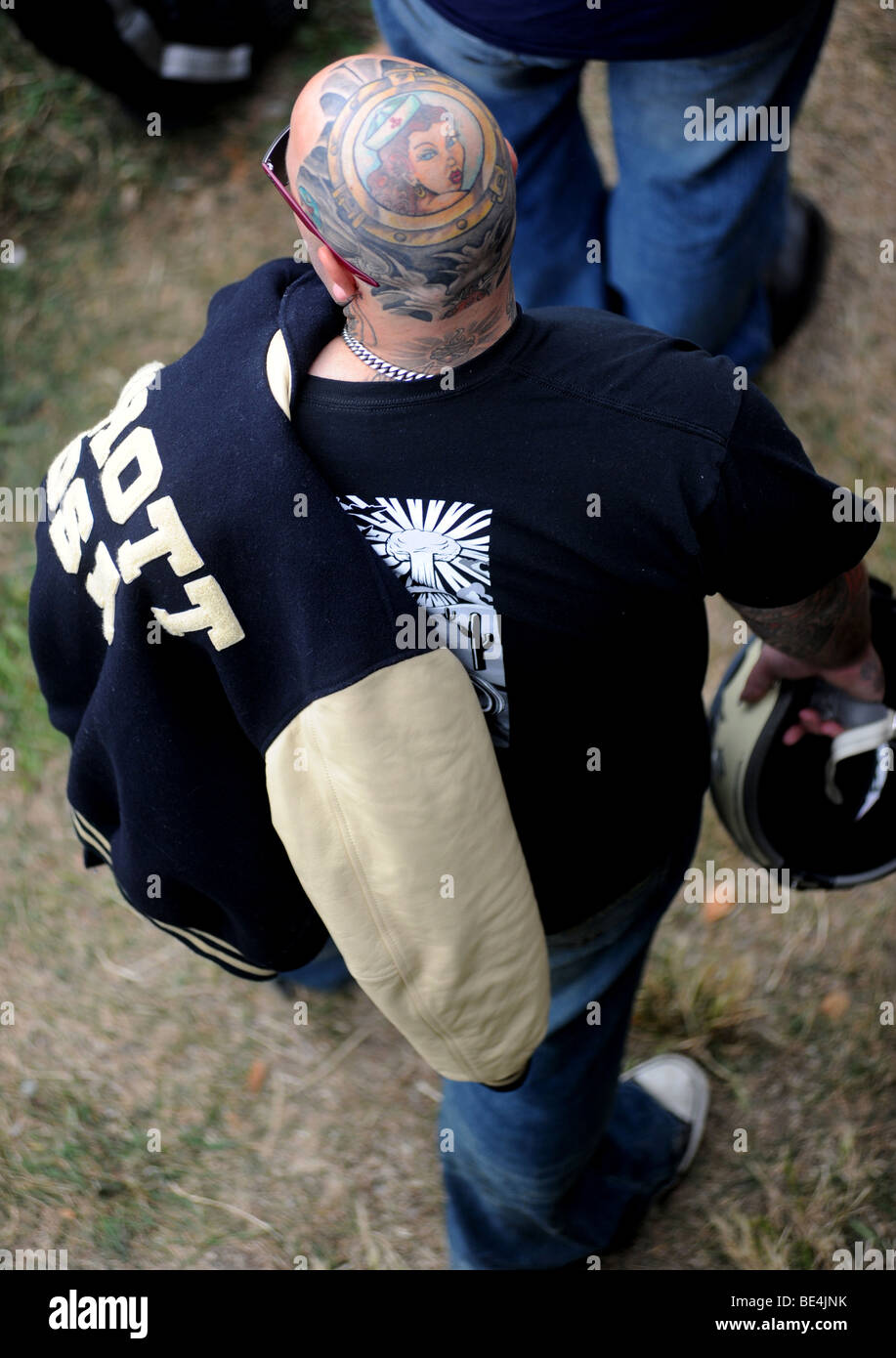 A biker with a tattooed head during the Ace Cafe Reunion 2009 - Stock Image