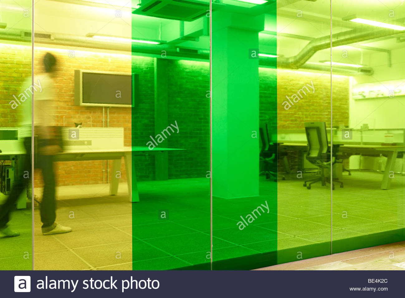 green yellow glass wall partition office - Stock Image
