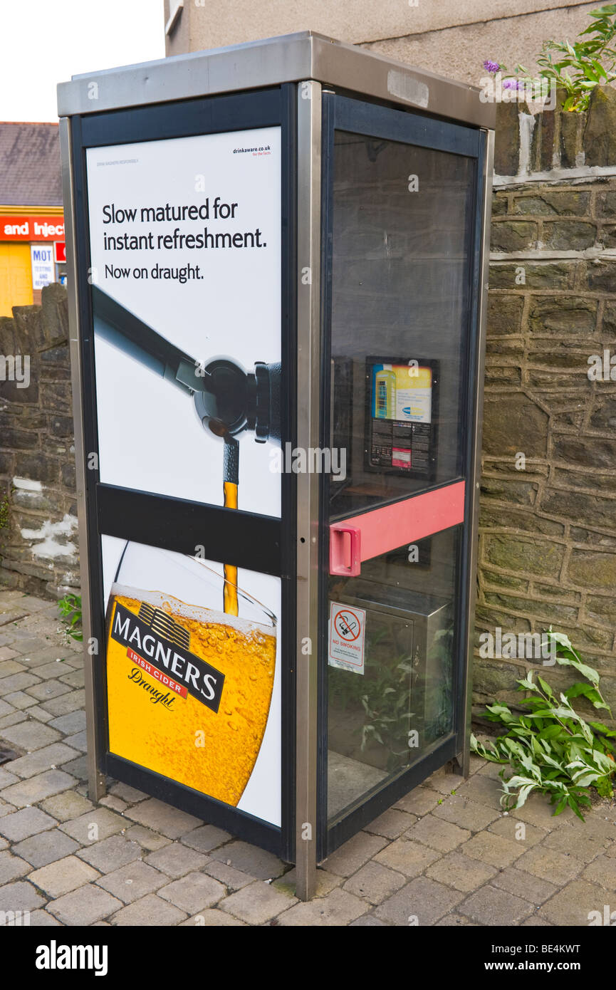 Billboard for Magners Cider on BT telephone box in UK - Stock Image