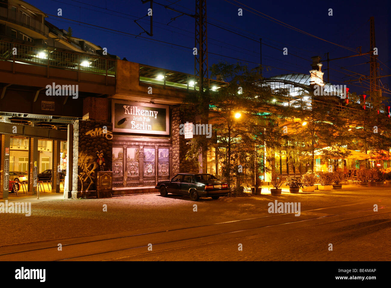 S-Bahnhof Hackescher Markt station with illumination for a pub at night, Mitte, Berlin, Germany, Europe - Stock Image