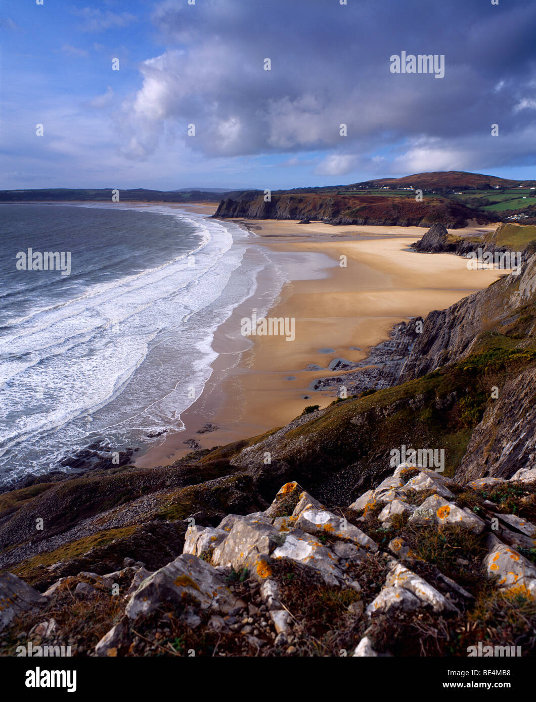 Threecliff Bay on the Gower Coast looking towards the village of Penmaen and Great Tor, behind which lies the beach - Stock Image