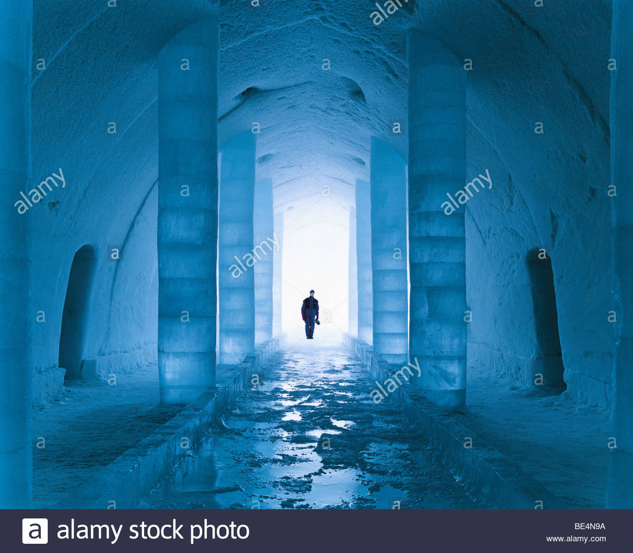 Man standing in an ice hotel, Sweden Stock Photo