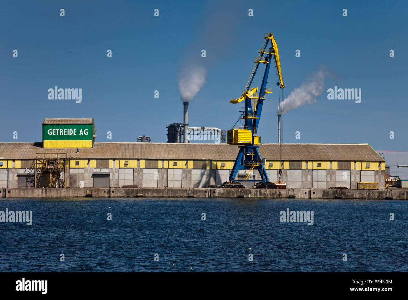 Warehouse and crane in the harbour of Wismar, Germany - Stock Image