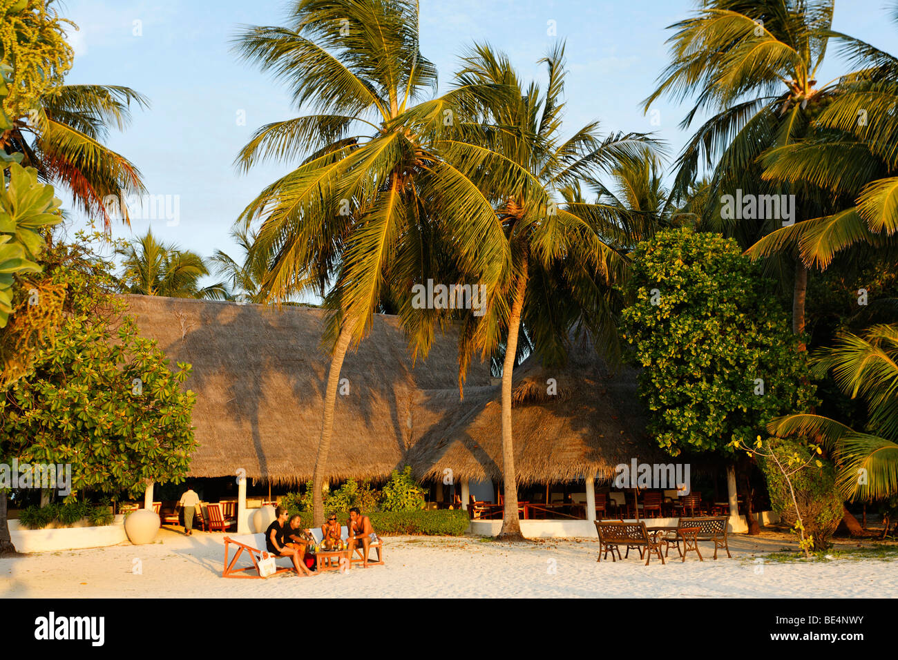 Guests in front of the lobby, bar, Maldive island, South Male Atoll, Maldives, Achipelago, Asia, Indian Ocean Stock Photo