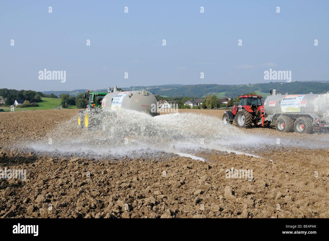 Dairy farmers dumping their milk in protest on a field, Overath, Rheinisch-Bergische Kreis, North Rhine-Westphalia, - Stock Image