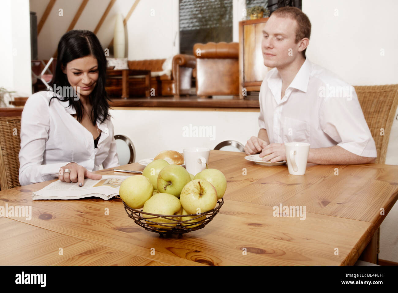 Young couple having breakfast together Stock Photo