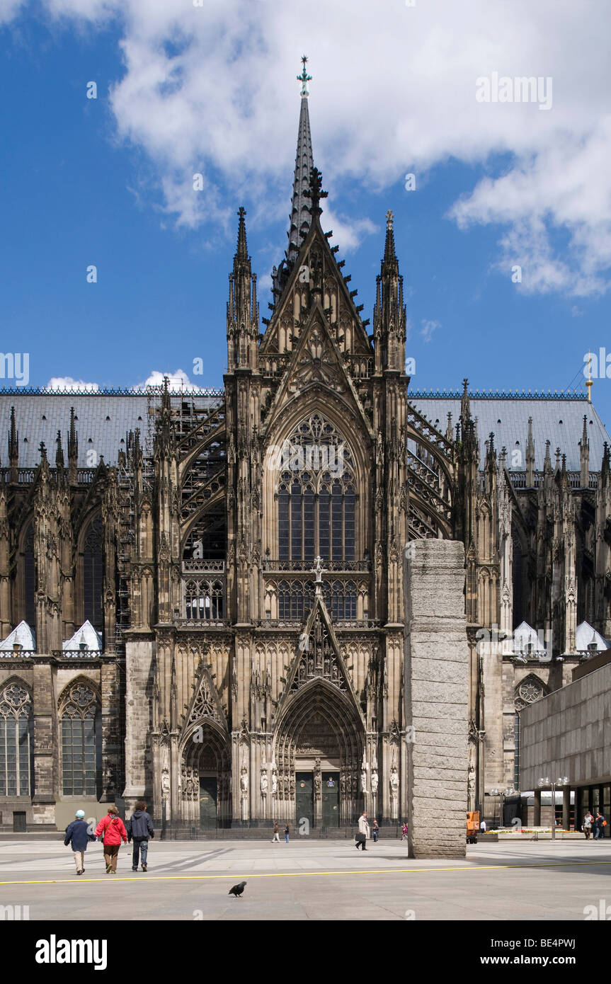 Cologne Cathedral, High Cathedral of St. Peter and Maria, portal of the southern transept, tourists walking in front, - Stock Image