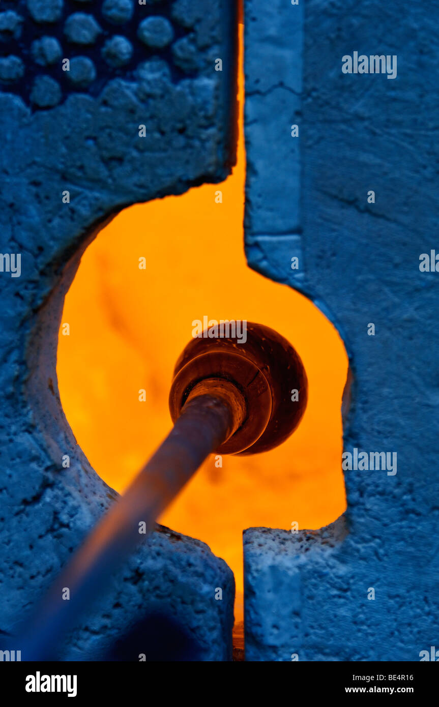 A Piece of Blown Glass being Reheated in Gas Furnace - Stock Image