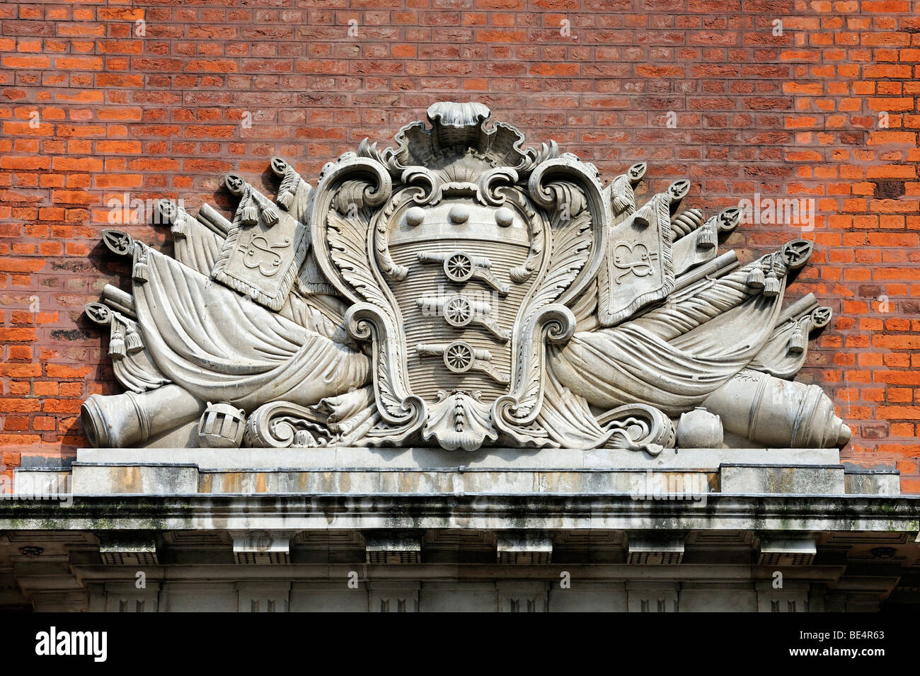 Coat of arms as a stone carving on a building in the Tower of London, England, United Kingdom, Europe - Stock Image