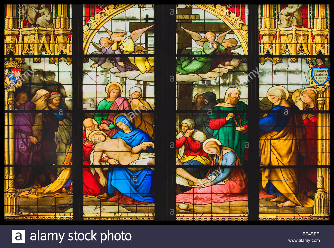 Cologne Cathedral, window depicting the Lamentation of Christ, dead Jesus Christ, rests in the lap of his mother - Stock Image