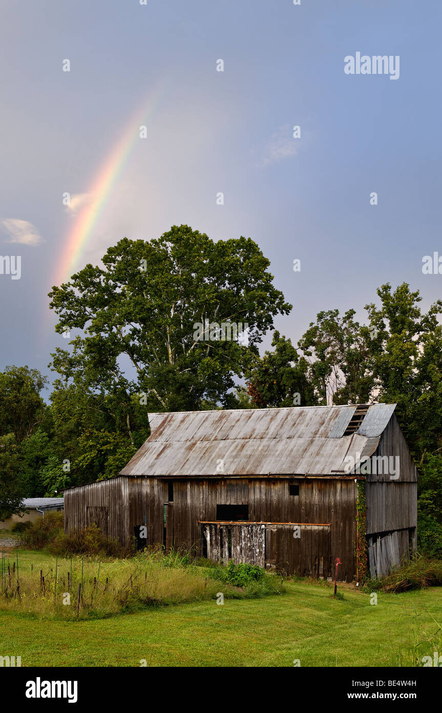 Rainbow over Old Barn in Floyd County, Indiana - Stock Image
