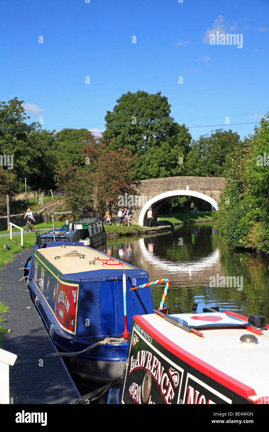 Narrow boats on the Leeds and Liverpool Canal at Greenberfield, Barnoldswick, Lancashire, England, UK. - Stock Image