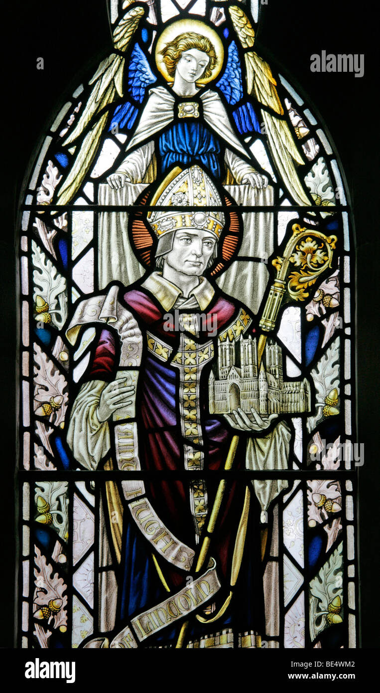 A Stained Glass Window Depicting Saint Hugh of Lincoln, All Saints Harmston, Lincolnshire - Stock Image