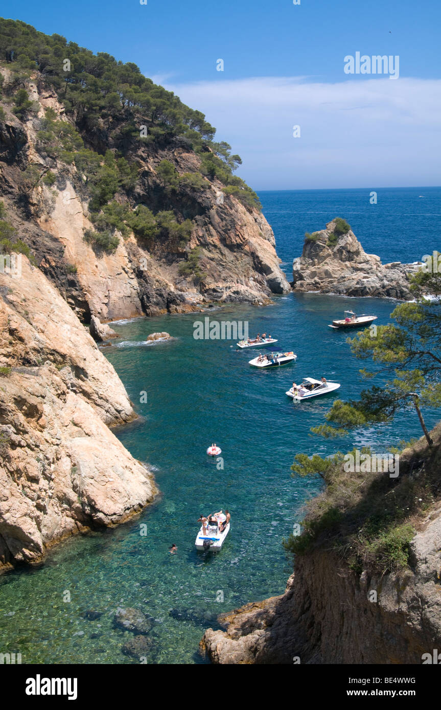 Boats anchored in a small inlet of the Palamos' coastline, Girona, Spain - Stock Image