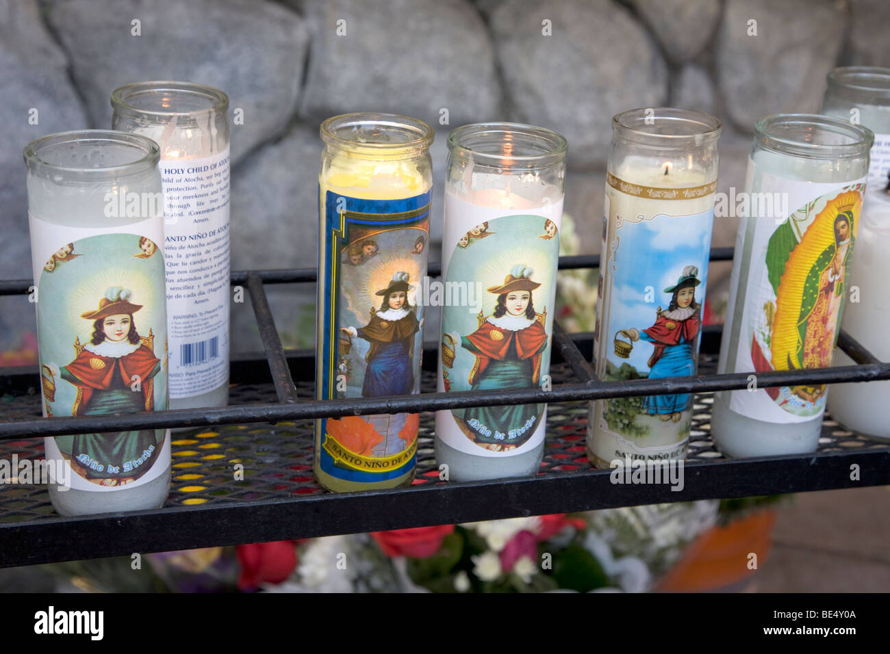 Candle Holders With Depiction Of The Holy Child Of Atocha For Protection Los Angeles - Stock Image