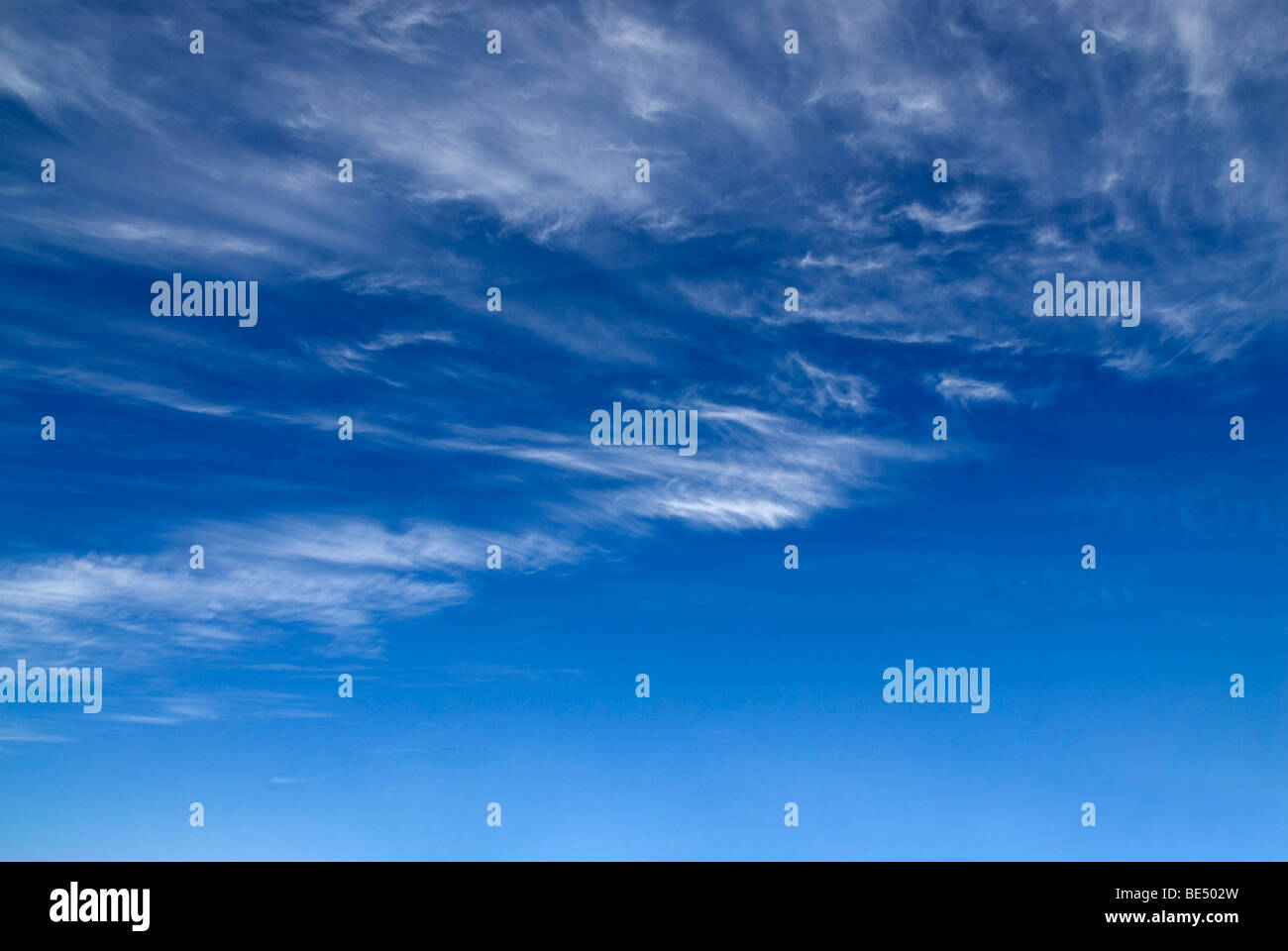 Veil of clouds against a blue sky - Stock Image