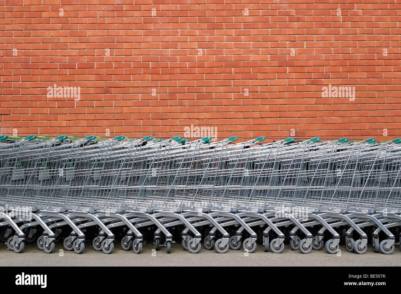 Shopping Trolleys Outside a Supermarket. - Stock Image