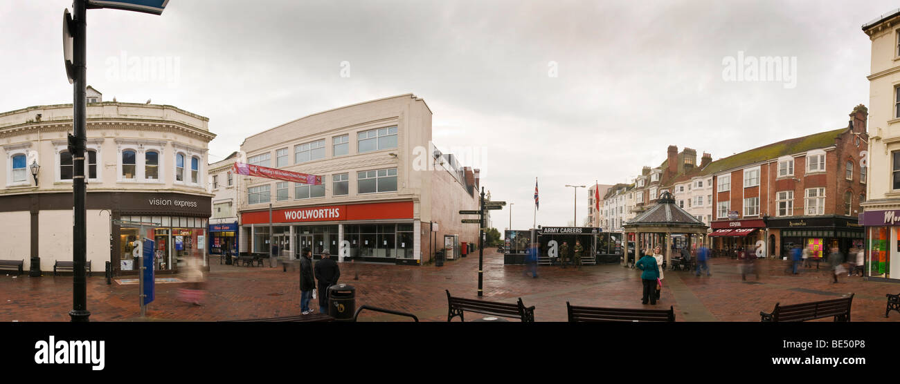 Panorama of gloomy Worthing town centre with recently closed-down Woolworths store - Stock Image