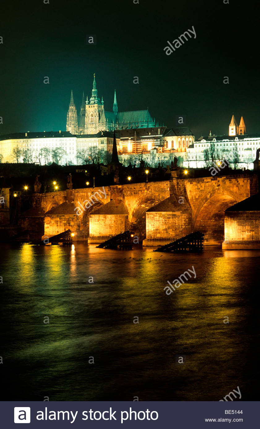 Czech Republic, Prague - Bridge across a river with a castle lit up at night in the background, Charles Bridge, Stock Photo