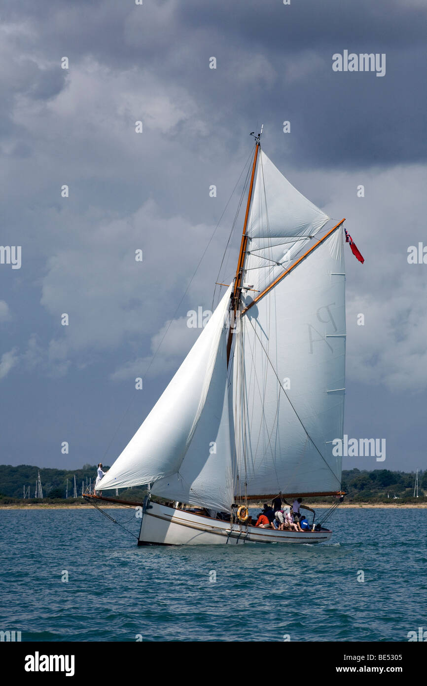 Bristol Pilot Cutter Polly Agatha Sail gaff rig fast tough channel sailing Solent Charter holiday 1904 crew teamwork - Stock Image