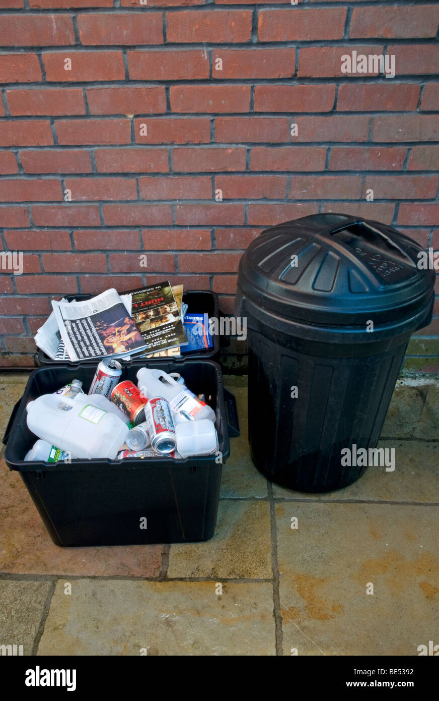 Domestic rubbish collection,  showing separated waste for re -cycling , Paper bin  Plastic Bin  and domestic household Stock Photo