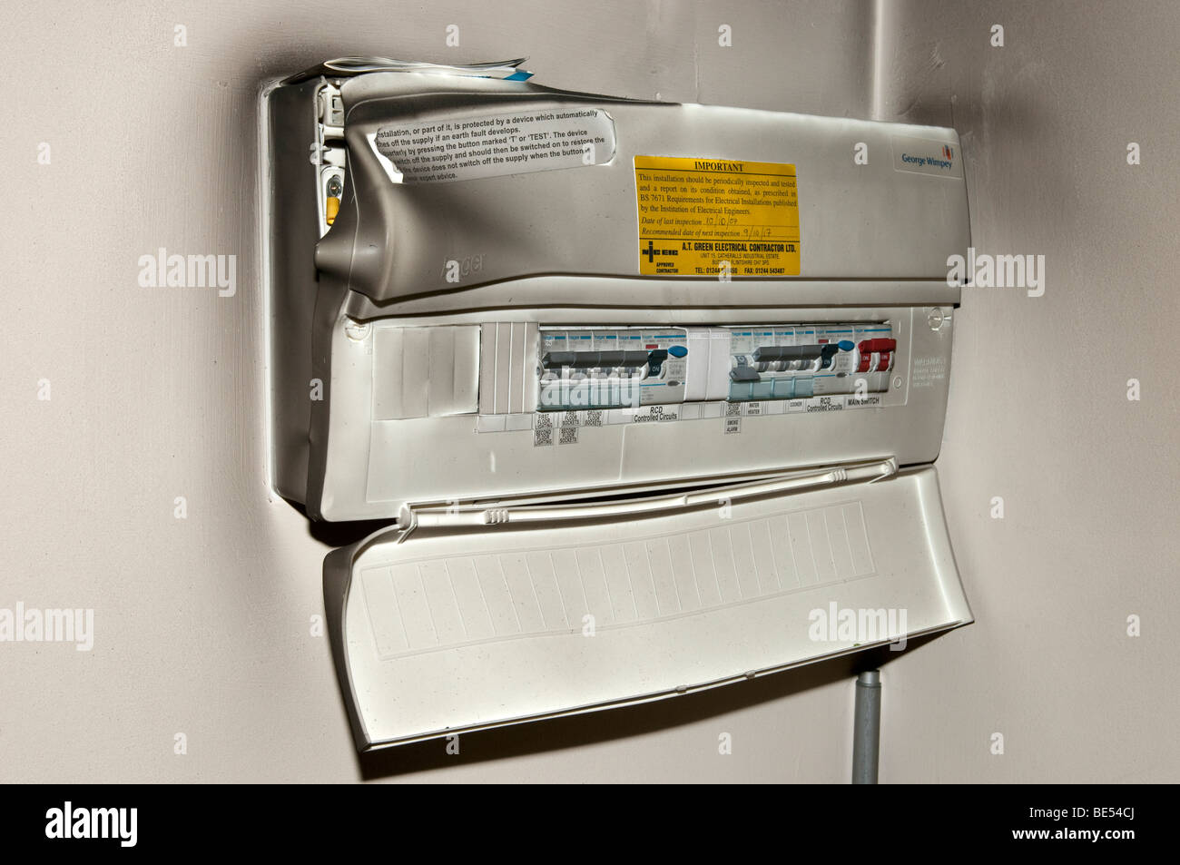 Domestic electrical consumer unit melted from house fire - Stock Image