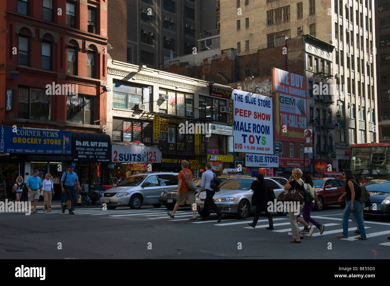 Stores along the east side of Eighth Avenue between 40th street and 39 street near Times Square in New York - Stock Image
