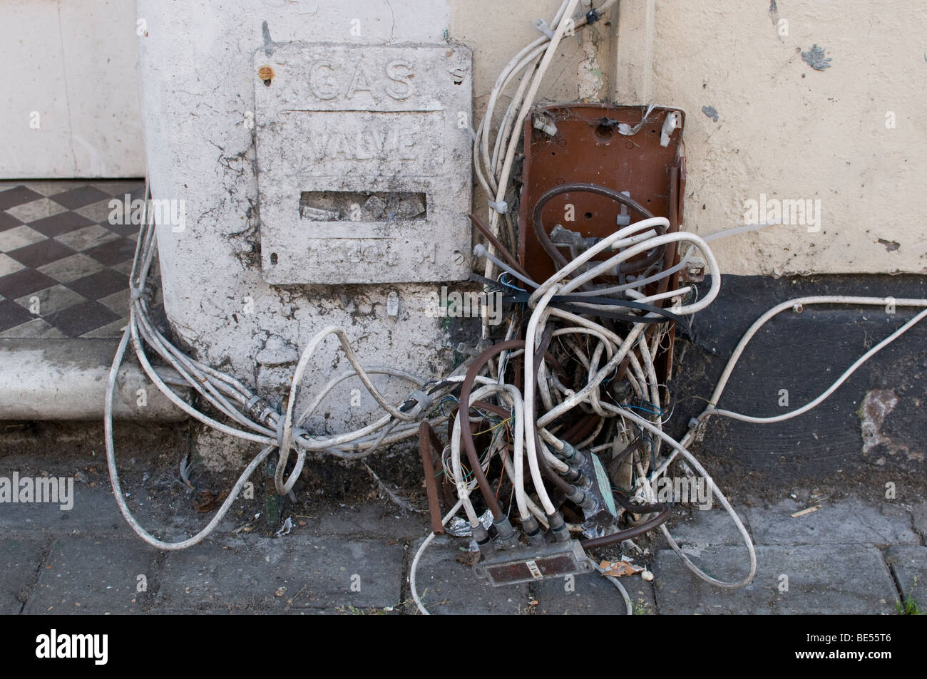 A mass of phone and cable TV leads and other tangled wiring Stock ...