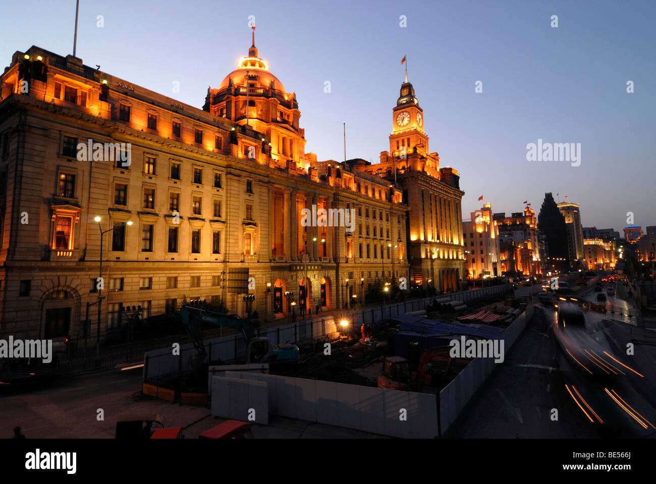 The illuminated Bund promenade at night, avenue in Shanghai, with HSBC Building, and China Merchants Bank Building, - Stock Image