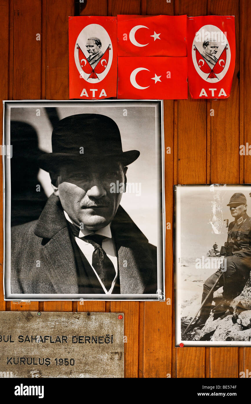 Photo portrait of Mustafa Kemal Atatuerk, and the foundation sign of the booksellers-association on a wall in the - Stock Image
