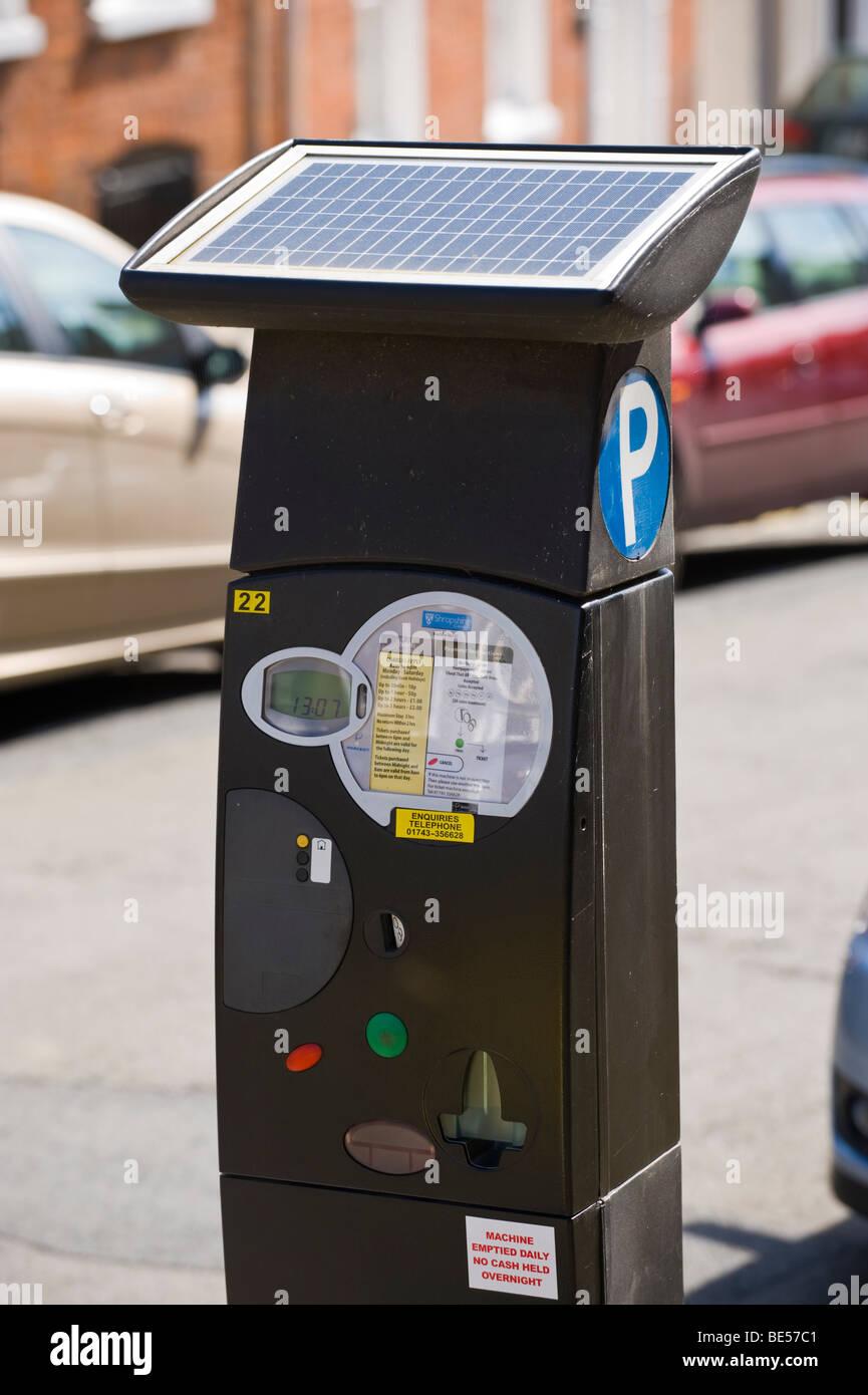 Parking meter ticket dispenser for on street parking powered by  solar panel  UK - Stock Image