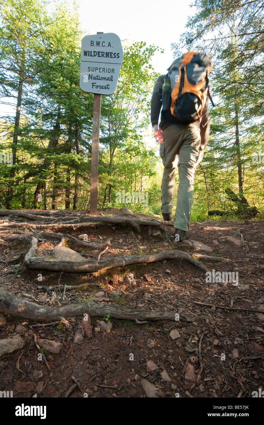 A BACKPACKER HIKES INTO THE BOUNDARY WATERS CANOE AREA - Stock Image