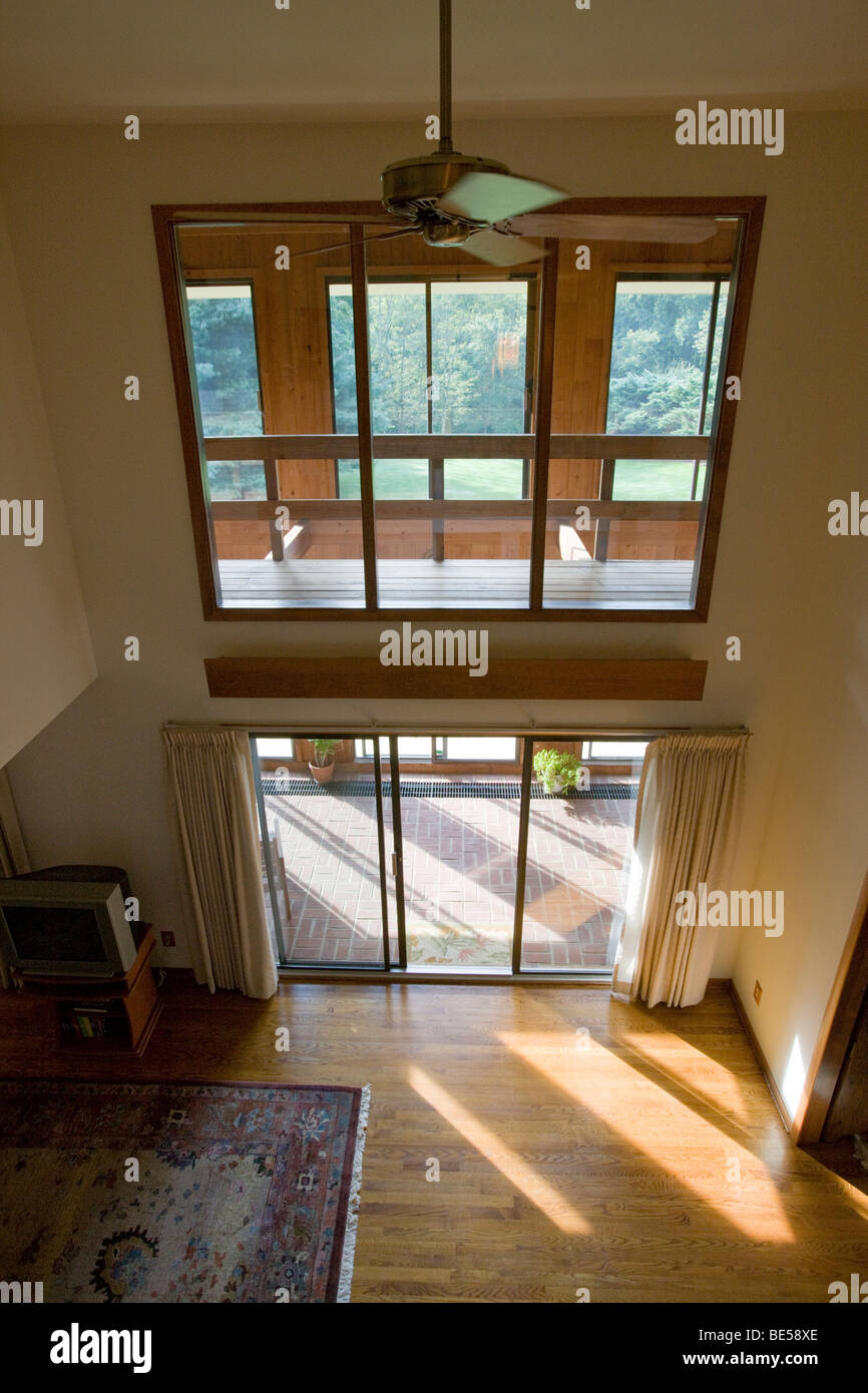 Interior view of a passive solar 'envelope house' design home in residential neighborhood. - Stock Image
