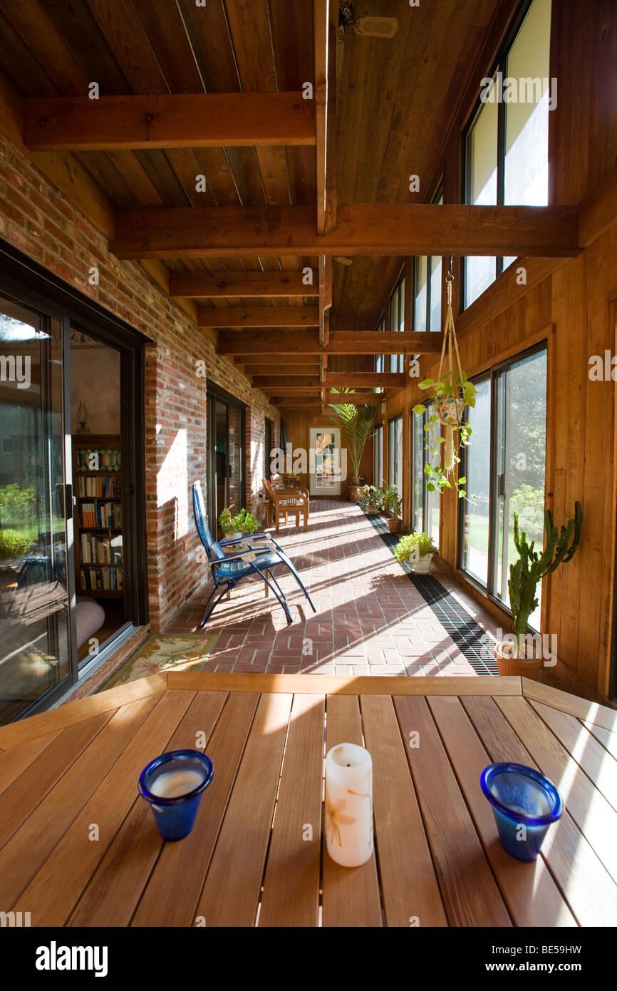 Interior view of the atrium (solarium) in a passive solar 'envelope house' design home in residential neighborhood. - Stock Image