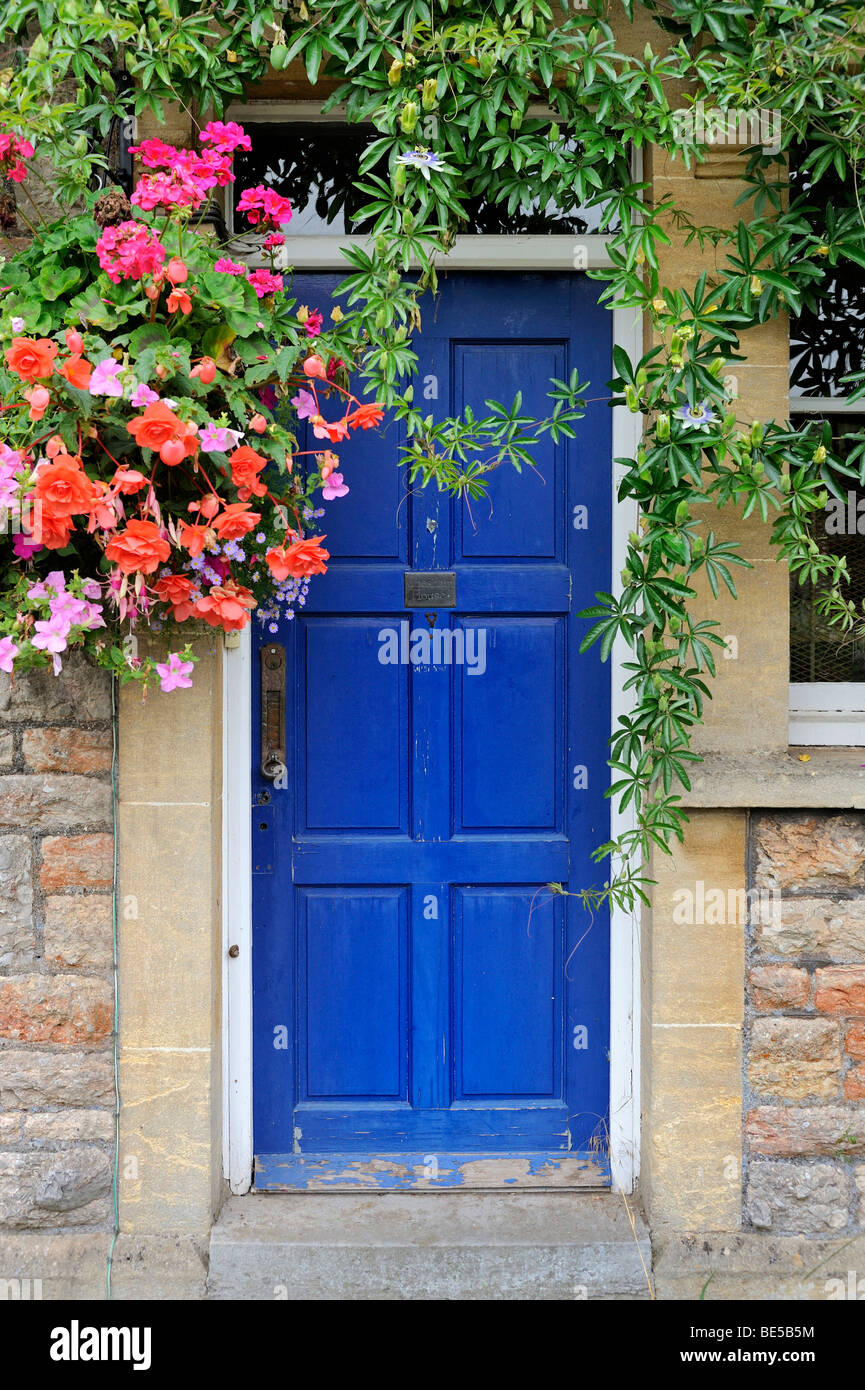 Front door with floral decoration on an old house in southern England, United Kingdom, Europe Stock Photo
